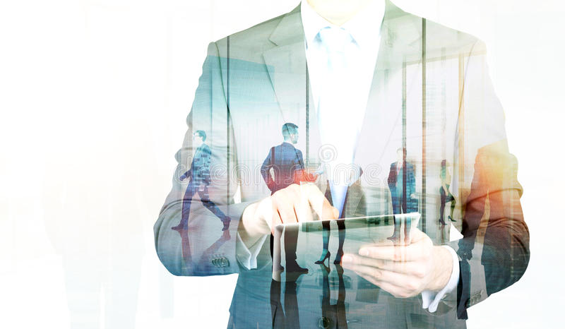 Businessperson with tablet multiexposure royalty free stock photography