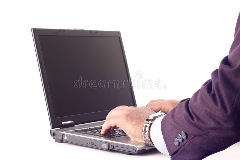 Businessperson working on a laptop computer royalty free stock photos