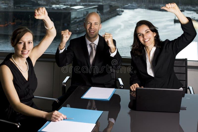 Businessteam celebrating stock photos