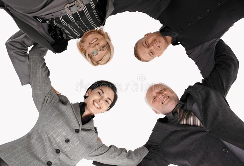 Download Businessteam Standing In Huddle, Smiling Stock Photo - Image: 18489914