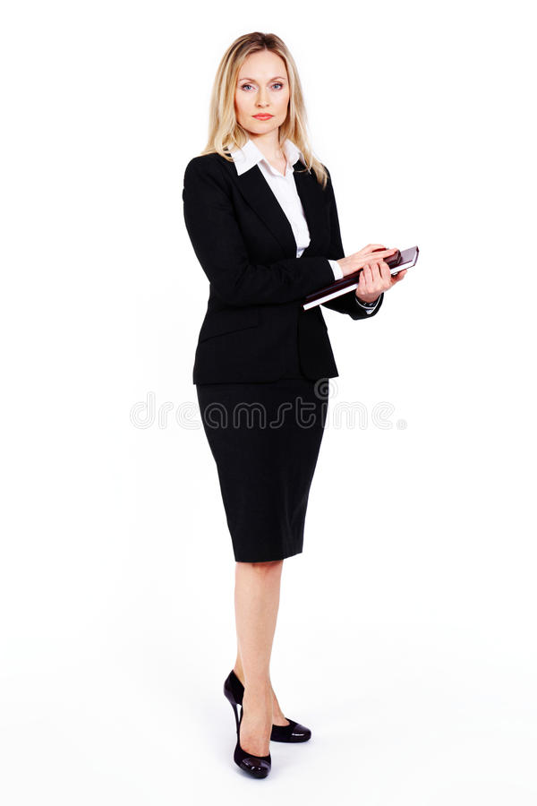 Businesswoman. Portrait of good-looking businesswoman standing in the studio royalty free stock photography