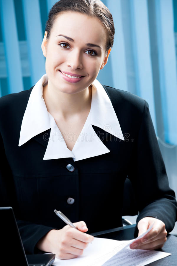 Businesswoman. With laptop at office stock images