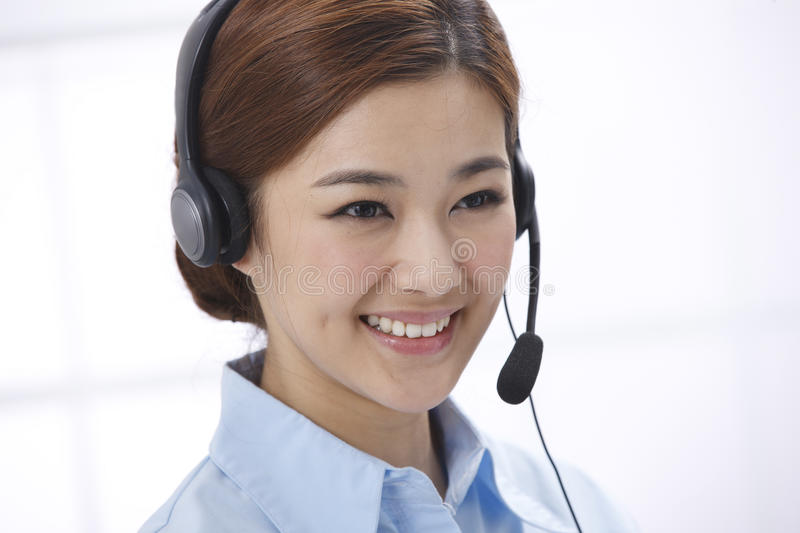 Businesswoman. Business woman with a headphone stock image