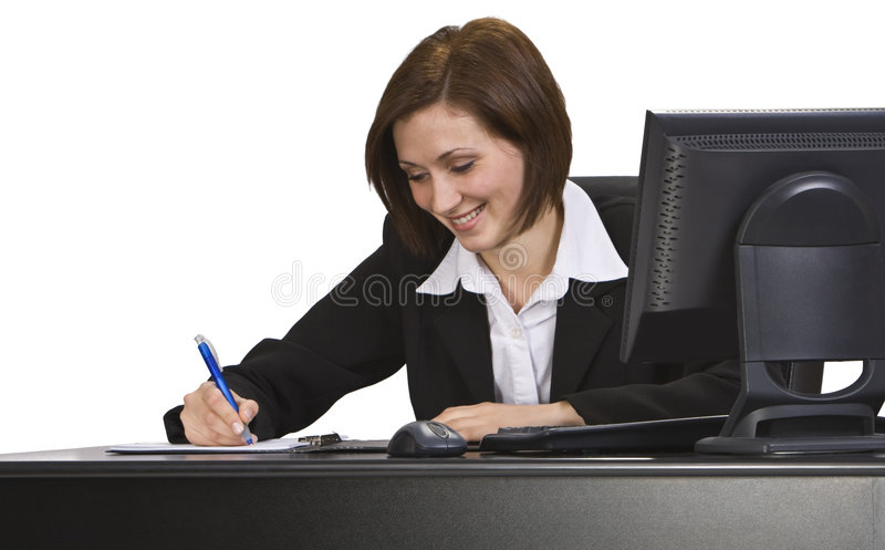 Businesswoman. Smiling businesswoman taking notes at her desk stock image