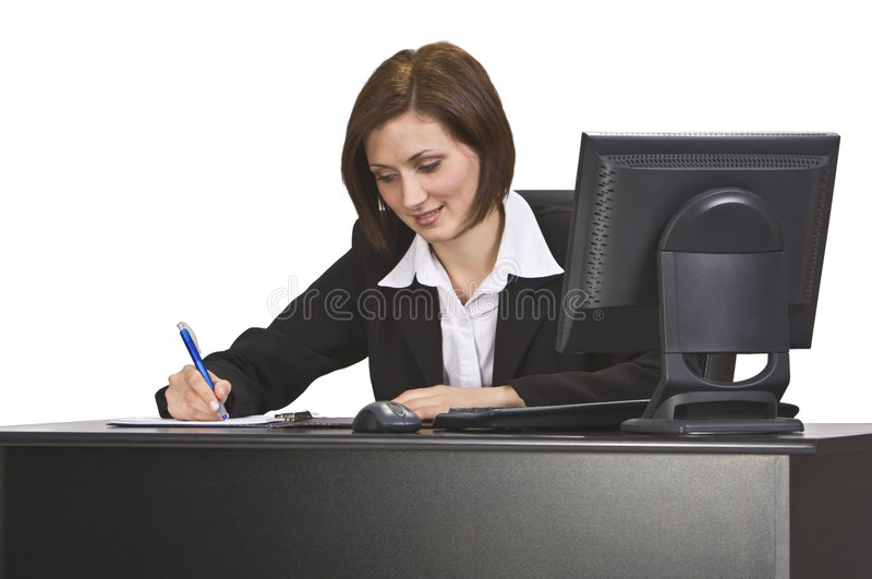 Businesswoman. Young businesswoman taking notes at her desk royalty free stock photography
