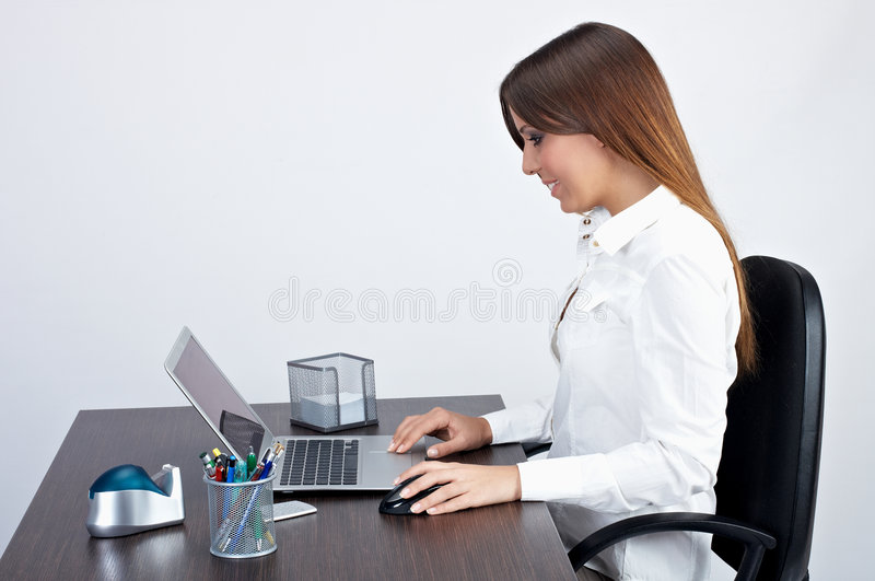 Businesswoman. Using laptop in office royalty free stock images