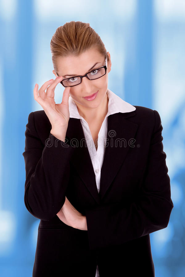 Businesswoman. Portrait of successful businesswoman with eye glasses royalty free stock photos