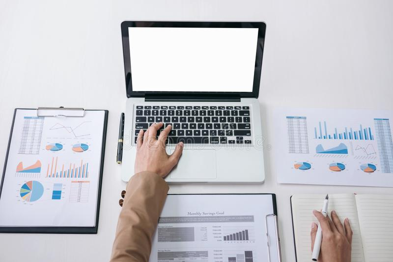 Businesswoman or accountant working Financial investment on laptop with Analyze business and market growth on financial document. Data graph and writing royalty free stock photography