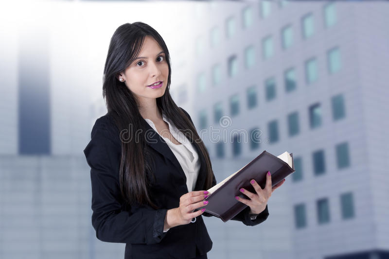Businesswoman with address book stock photo
