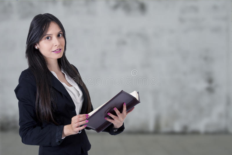 Businesswoman with address book royalty free stock photo