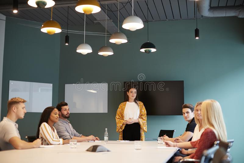 Businesswoman Addressing Group Of Candidates Meeting Around Table At Graduate Recruitment Assessment Day royalty free stock images