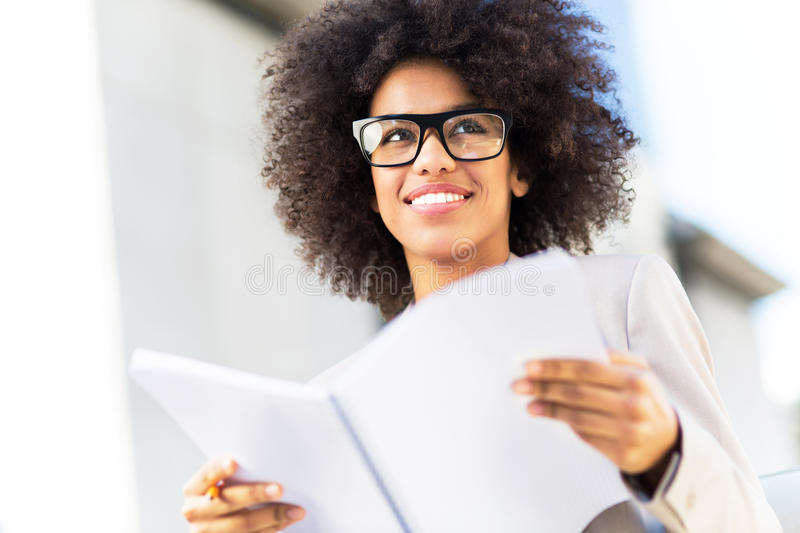 Businesswoman with afro hair stock photos