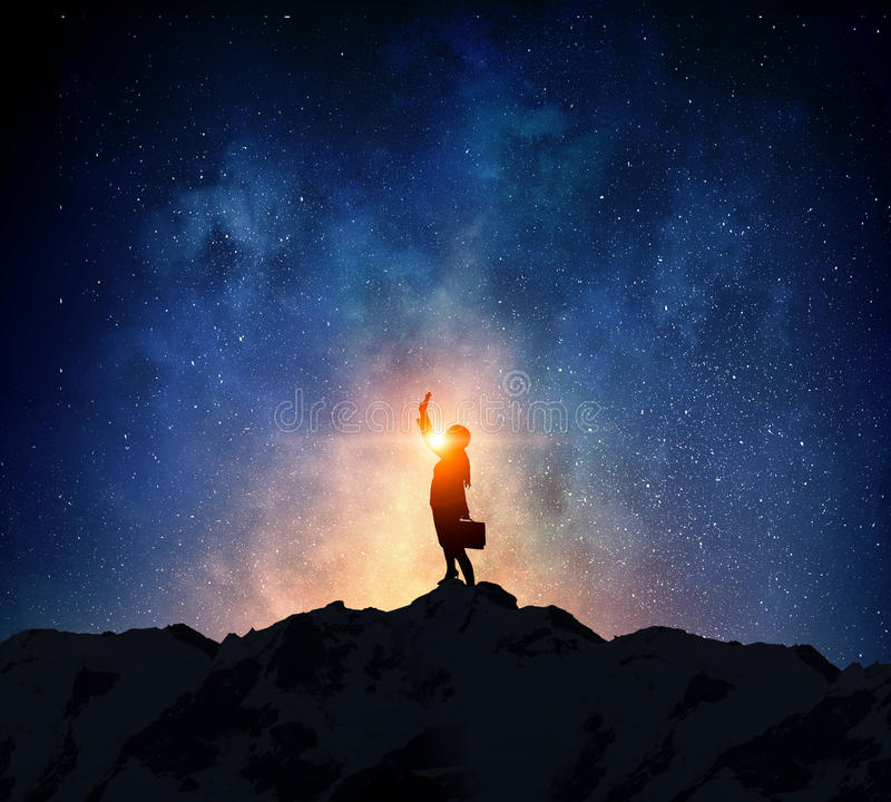 Businesswoman against starry sky . Mixed media stock images