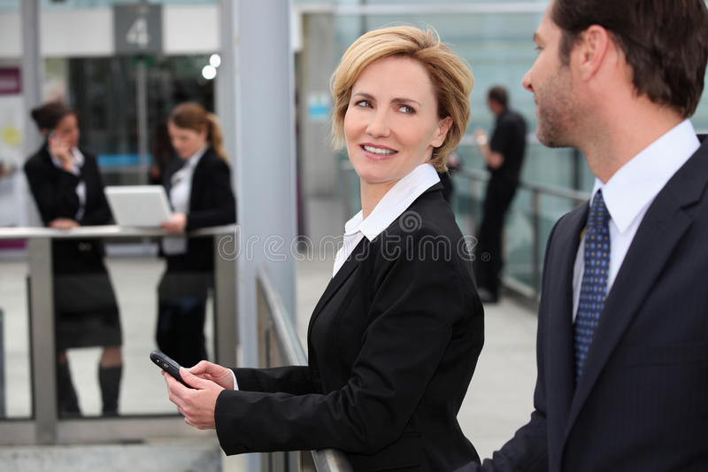 Businesswoman at an airport. Businesswomen and colleague at an airport royalty free stock images