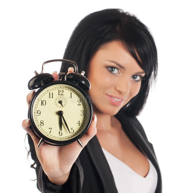 Businesswoman with alarm clock stock photo