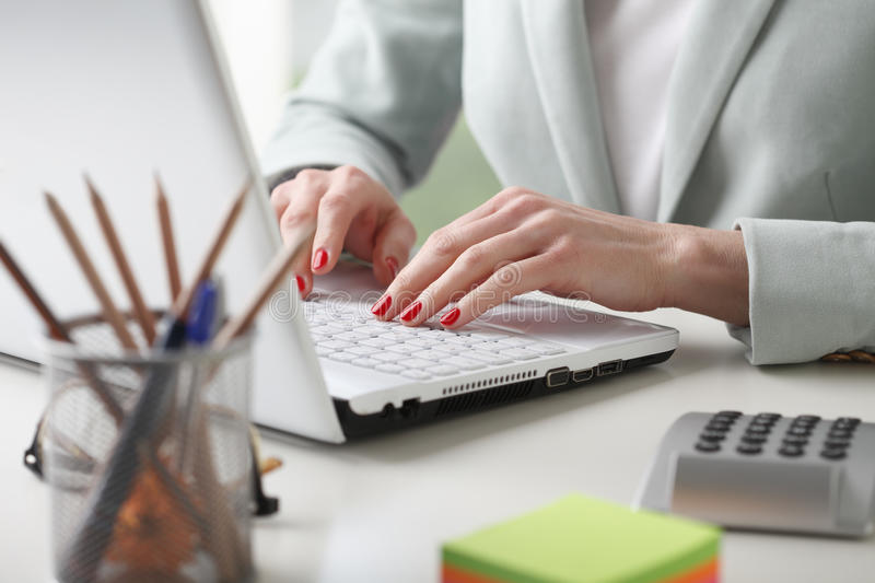 Businesswoman analyzing data. Close-up of businesswoman working on accountancy with laptop. Small business stock images