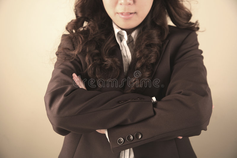 Businesswoman With Arms Folded Stock Photography
