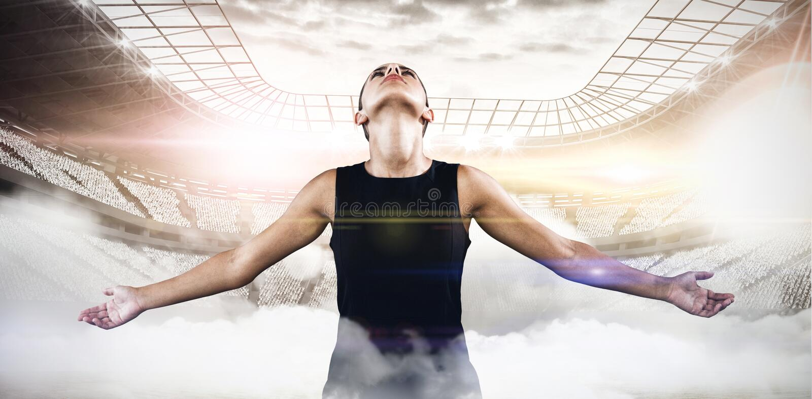 Composite image of businesswoman with arms outstretched stock photos