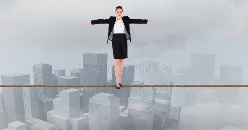 Businesswoman with arms outstretched standing on rope over city stock illustration