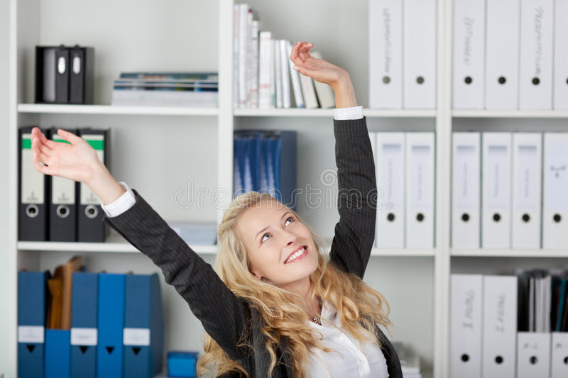Download Businesswoman With Arms Raised In Office Stock Photo - Image: 31202996