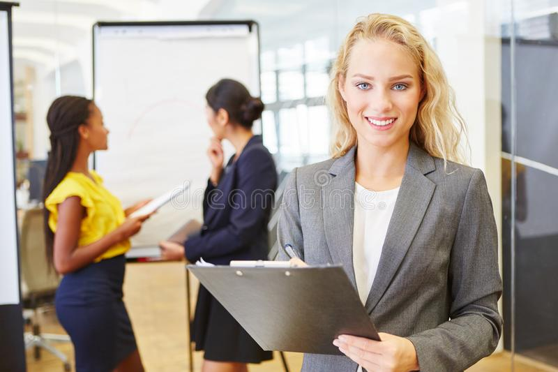 Businesswoman as business consultant. With clipboard and checklist royalty free stock image
