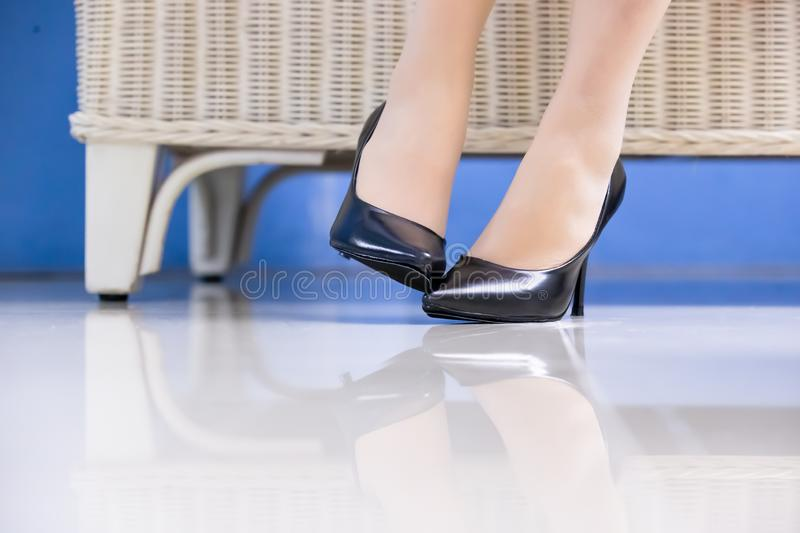 Businesswoman with athlete foot stock photos
