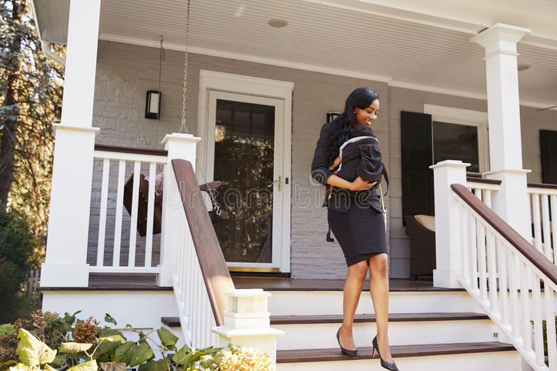 Businesswoman With Baby Son Leaving House For Work stock photos