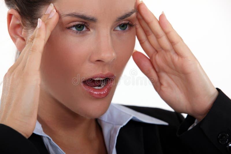 Businesswoman with a bad headache. stock photo