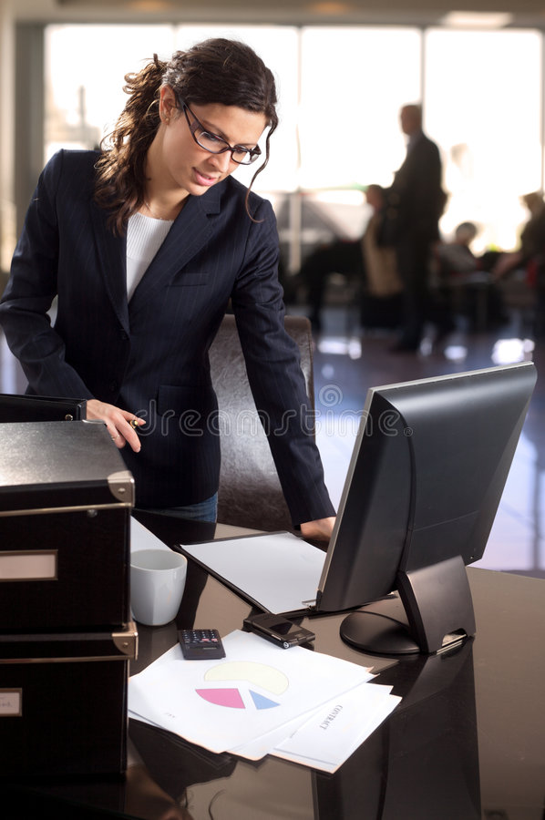 Businesswoman in bank lobby stock photo