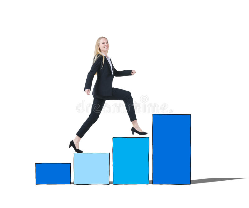 Businesswoman on a Bar Graph Moving Up.  royalty free stock image