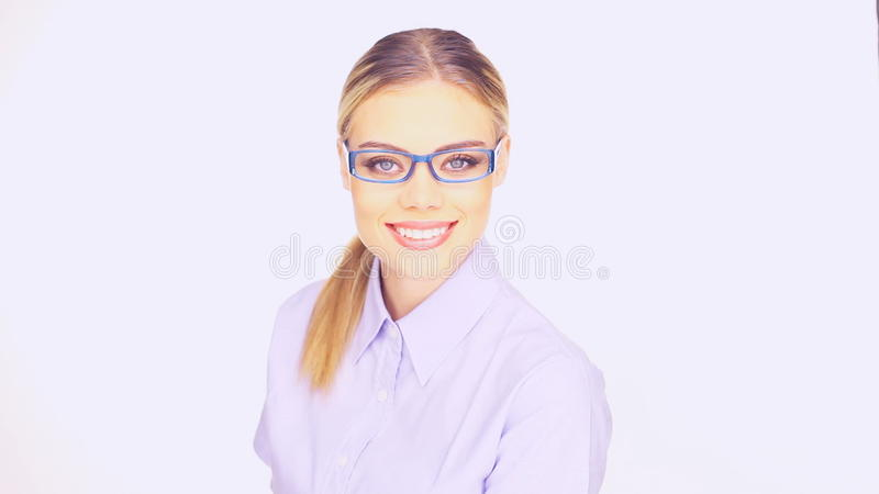 Businesswoman with a beaming friendly smile. Beautiful young businesswoman with long blond hair wearing trendy glasses giving a beaming friendly smile stock video footage