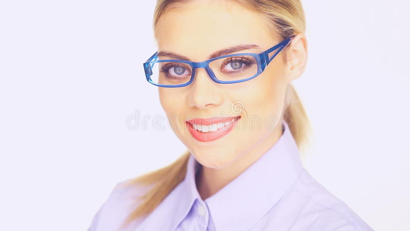Businesswoman with a beautiful smile. Wearing trendy modern glasses, closeup head and shoulders studio portrait stock video
