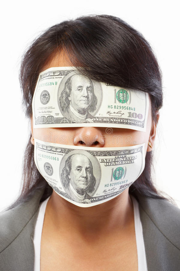 Businesswoman being blinded with money. For bribing or corruption concept stock photos