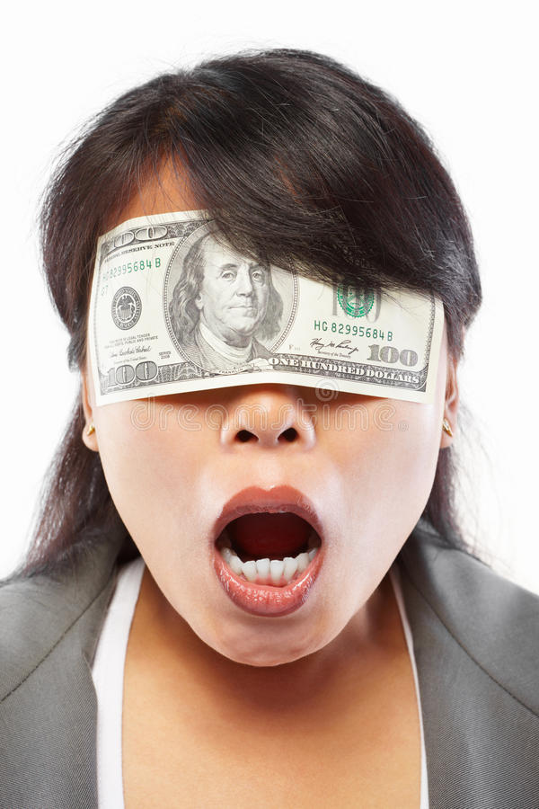 Businesswoman being blinded with money. For bribing or corruption concept royalty free stock image