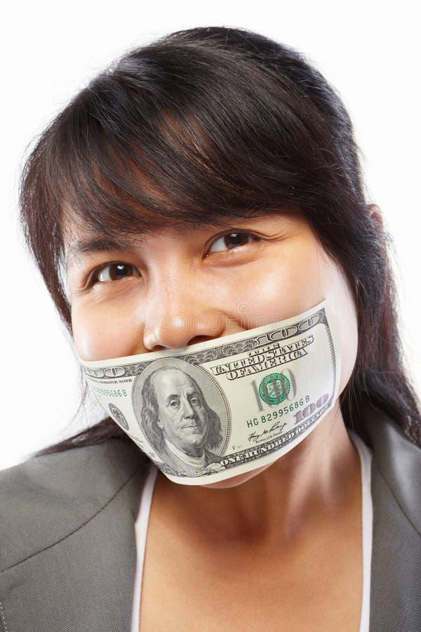 Businesswoman being bribed stock image