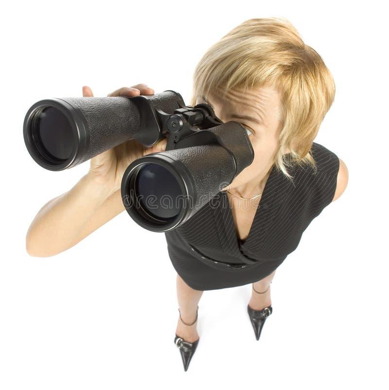 Businesswoman with binoculars royalty free stock photo