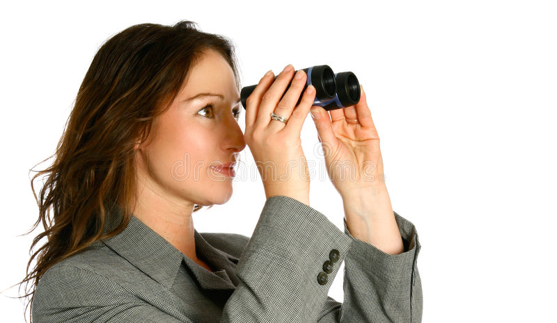 Businesswoman with binoculars royalty free stock photography