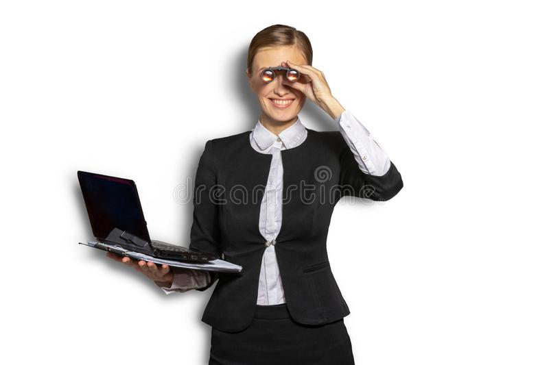 Businesswoman with binoculars on an isolated. Businesswoman with a laptop in his hand looking through binoculars in the hope of prospects and success. The stock photography