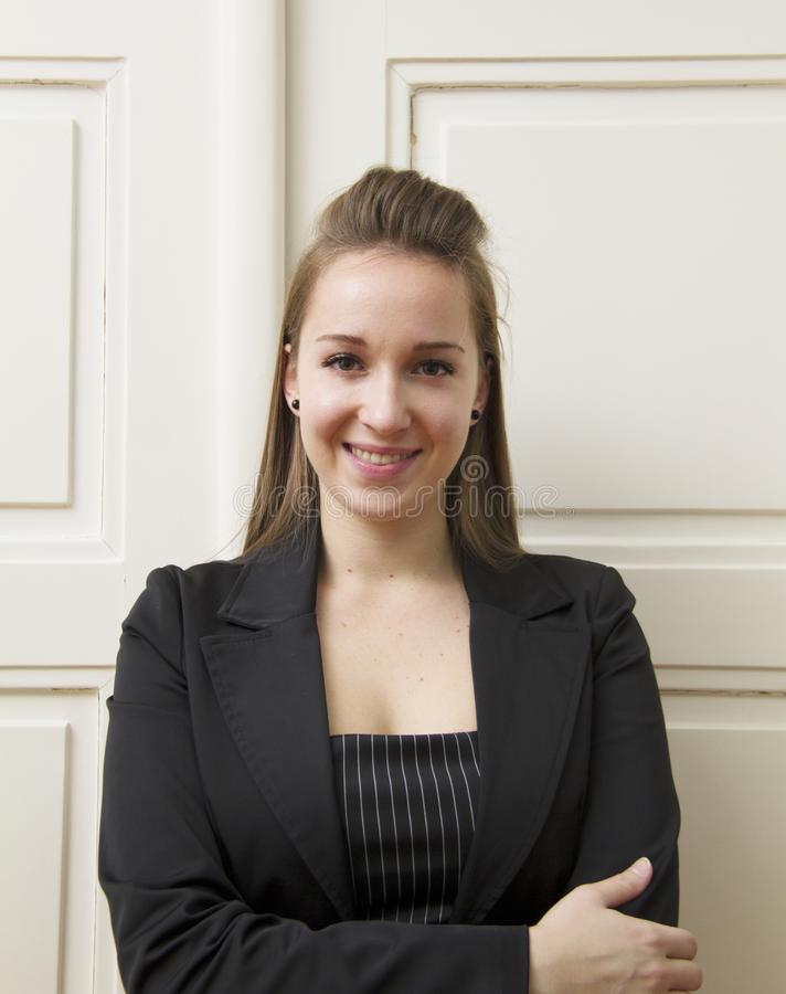 A businesswoman in a black suit. royalty free stock photos