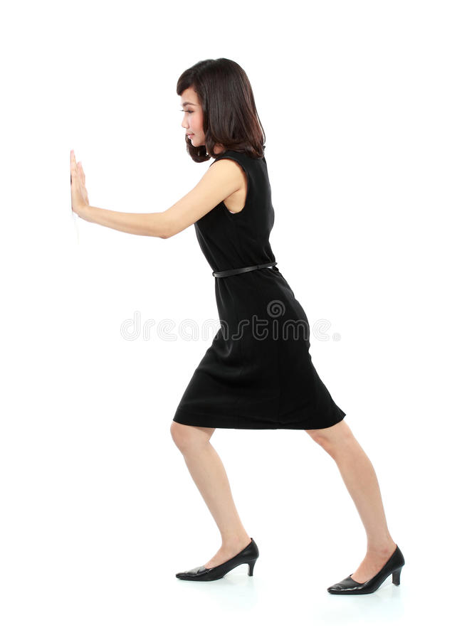 Businesswoman pushing the wall stock images