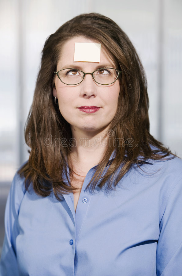 Businesswoman With A Blank Note On Her Forehead Royalty Free Stock Photography