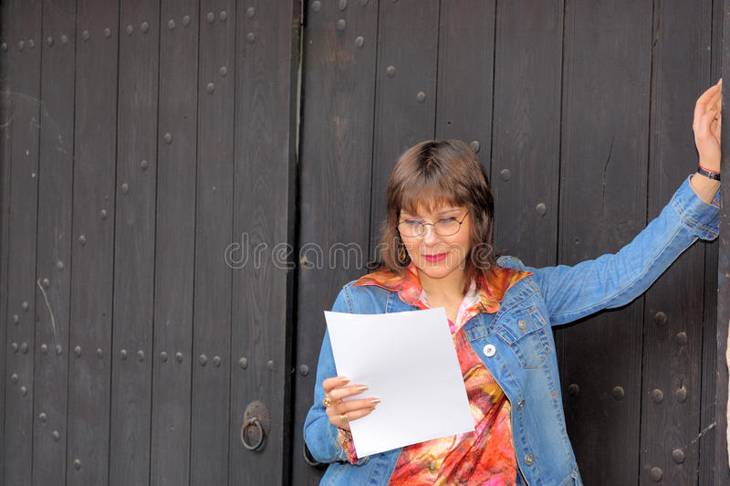 Businesswoman with blank paper stock photos