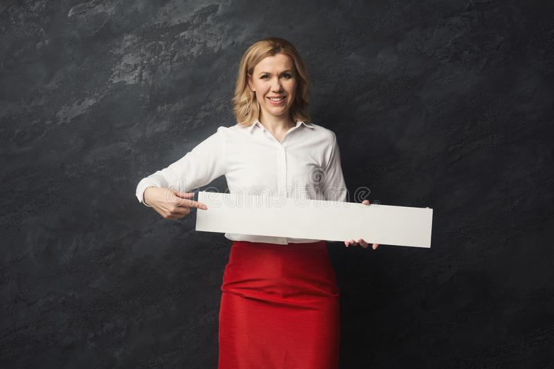 Businesswoman with blank white paper stock photography