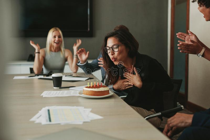 Businesswoman celebrating her birthday in the office stock photos