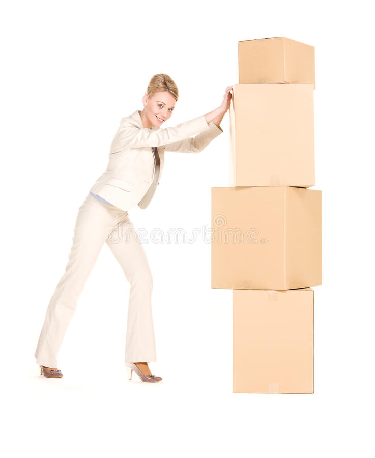Businesswoman with boxes royalty free stock image