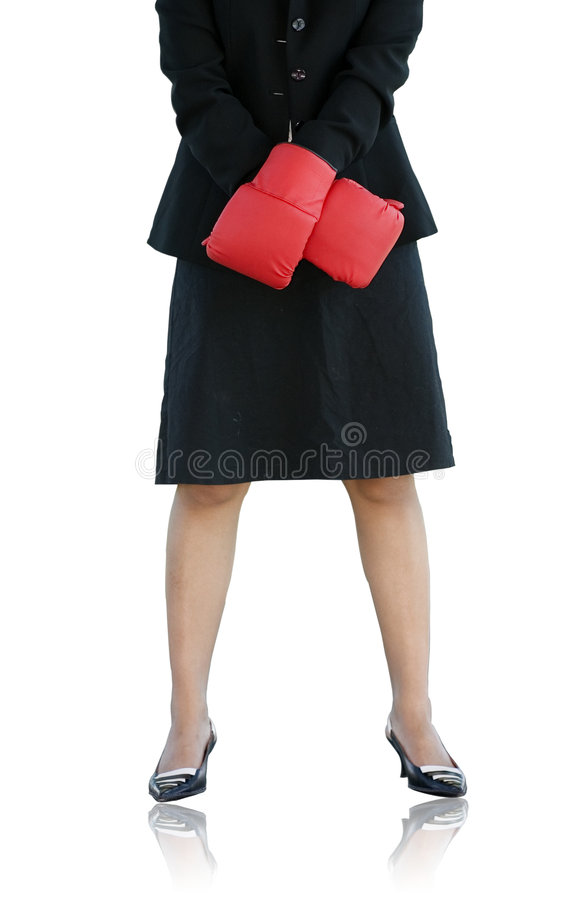 Businesswoman with boxing glove. Businesswoman standing tall ready to compete royalty free stock photo
