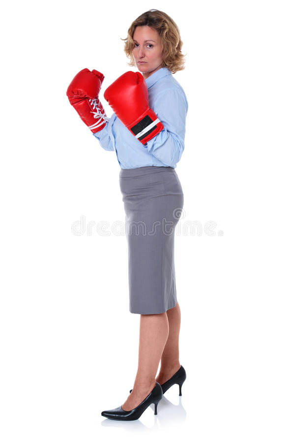 Businesswoman in boxing gloves side view