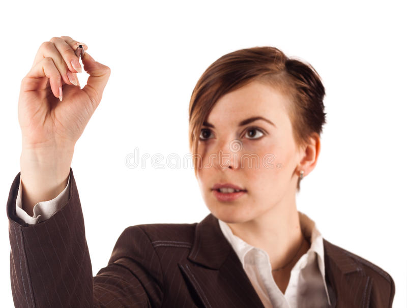 Businesswoman in brown suit with pencil stock photography