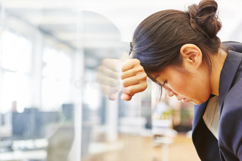 Businesswoman with burnout in the office stock photos
