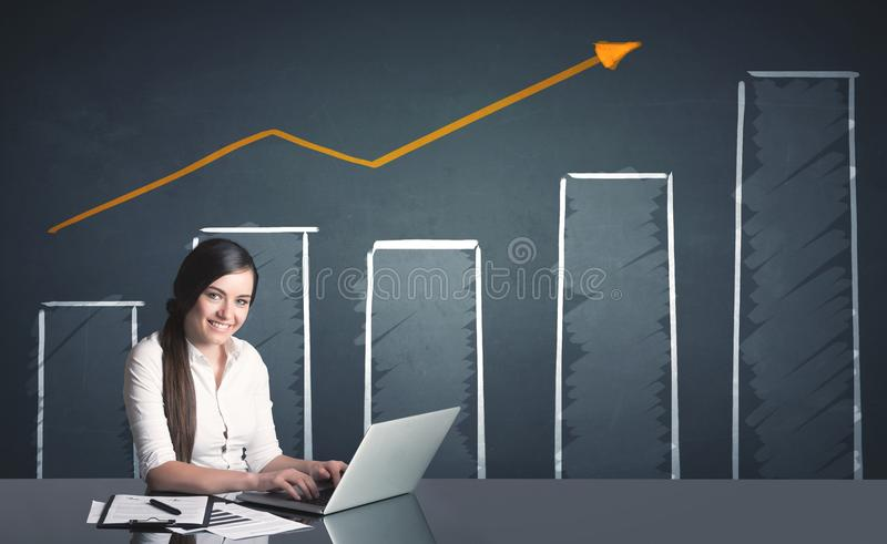 Businesswoman with business diagram royalty free stock photography